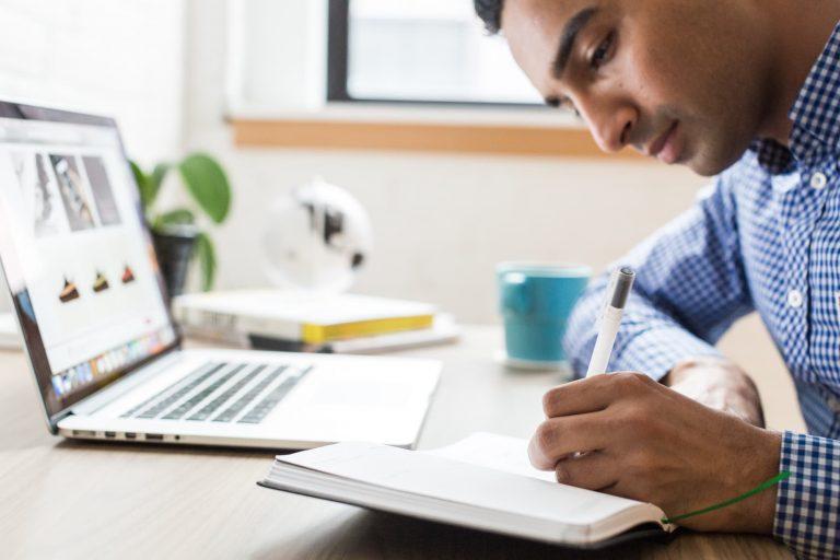 man using a computer to make a website